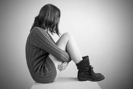 retouched: Sad girl in a sweater