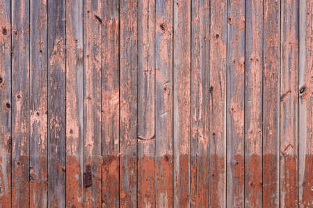 Pink and brown old wood texture. The wall of an old building.