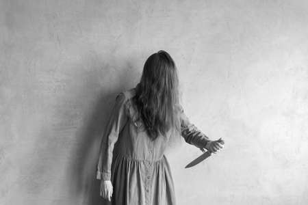 Furious woman with a knife