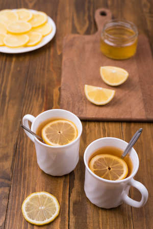 Composition with lemon tea on a wooden table