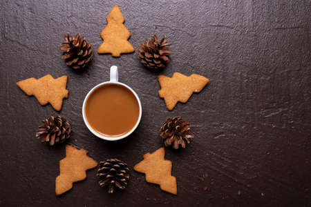 Coffee with cookies in shape of Christmas tree