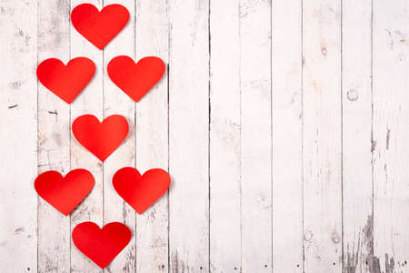 Flatlay composition with hearts on a wooden background. Love and St.Valentine's day concept.