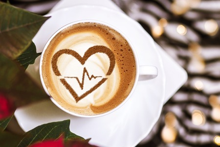 Heart with cardiogram line made on a cup of coffee Stock Photo