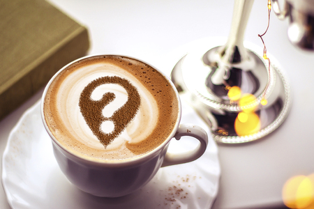 Coffee cup with question mark in the froth concept for problems, uncertainty and asking questions