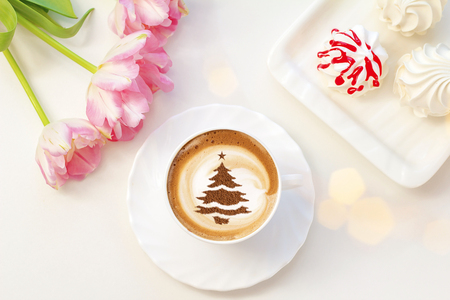 cup of Christmas cappuccino coffee with a Christmas tree pattern