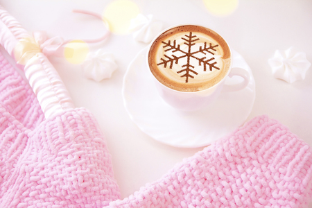 Cappuccino with a pattern of snowflakes from cinnamon on milk foam during Christmas holidays / coffee for christmas