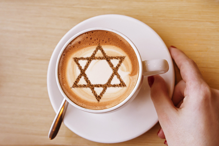 a cup of coffee in Israel cappuccino with a picture of the star of David Stock Photo