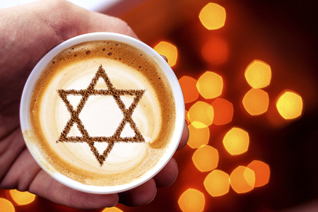 a cup of coffee in Israel cappuccino with a picture of the star of David Archivio Fotografico