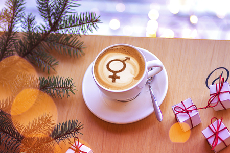 symbol of gender equality on milk foam coffee