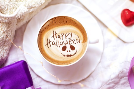 cup of coffee with the inscription happy halloween Stock Photo