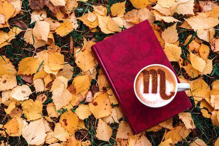 cup of cappuccino coffee with scorpion zodiac symbol picture