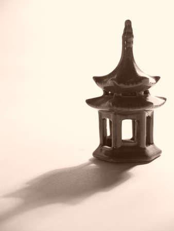 Porcelain chinese pagoda on gray background