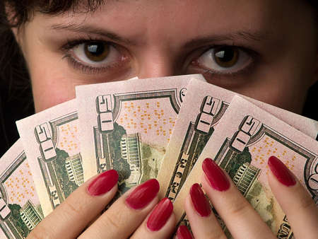 Beautiful lady holds dollars like a feather. Stock Photo