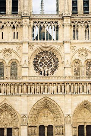 notre dame: Notre Dame de Paris facade closeup vertical Stock Photo
