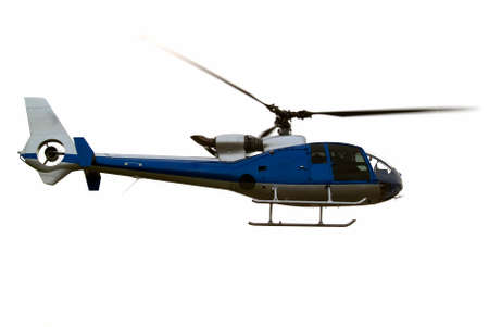 Civil helicopter hovering ready to climb and cruise Stock Photo