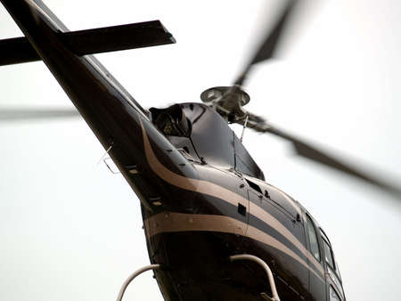 Hovering helicopters tail close-up low angle view