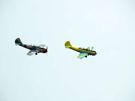 Two small propeller planes performing group aerobatics Stock Photo