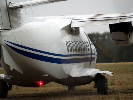 turboprop: Small turboprop commuter plane rolling on taxiway