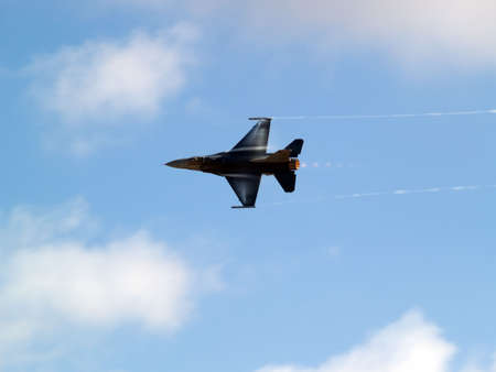 contrail: F-16 Fighting falcon turns with supersonic contrail