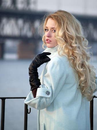 overcoat: Beautiful blonde lady in overcoat on promenade