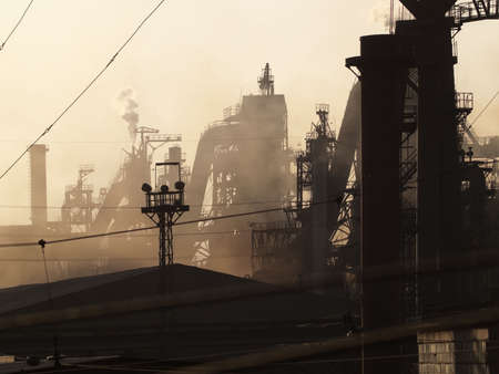 metallurgical: Heavy metallurgical plant in sunset light tele zoom Stock Photo