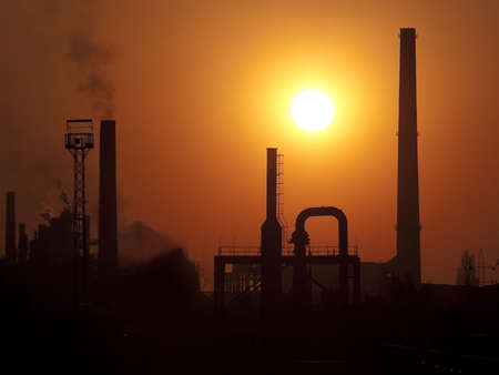 steelworks: Heavy metallurgical plant in sunset light tele zoom Stock Photo