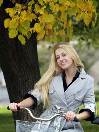 Young woman on bicylce photo