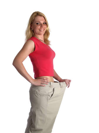 Girl in big pants on white smiling Stock Photo