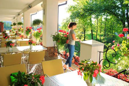 outdoor restaurant: Woman in outdoor restaurant