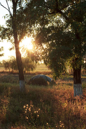 Haystack on autumn sunset