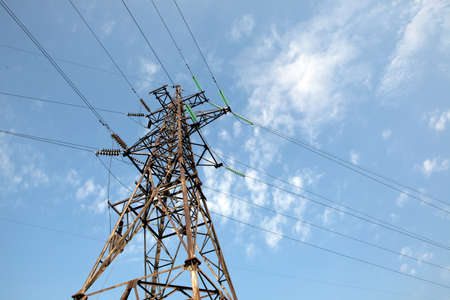 metalline: There is a power transmission line by an interesting angle of view under blue sky. Stock Photo