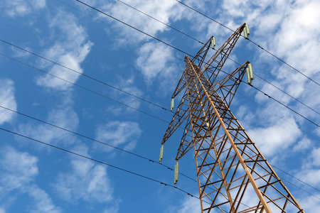 metalline: There is a electric line by an interesting angle of view under blue sky.