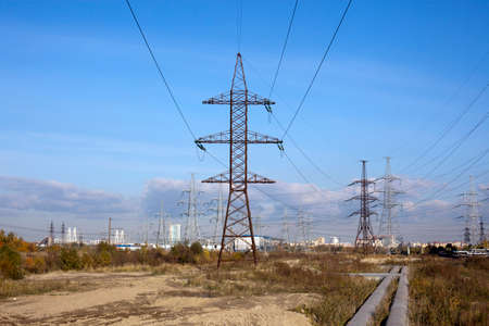 metalline: There is a power transmission line under blue sky.