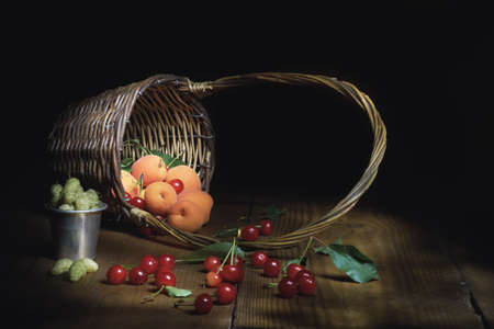 Fruit mix with apricots, cherries and mulberries on wooden table. Reklamní fotografie