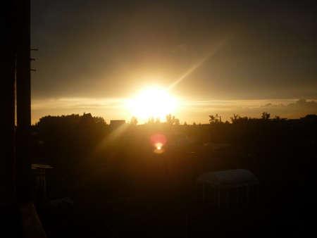 darken: good red sunset over darken sea Stock Photo