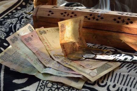 rupee: Indian rupees and incense burner