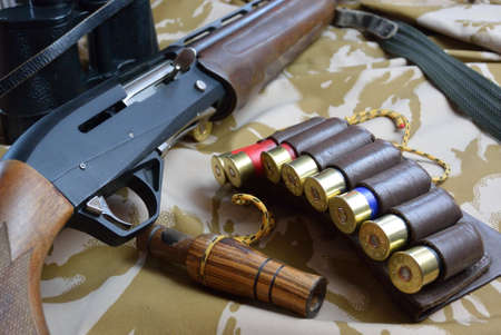 ammo: some large-caliber ammoes in the ammo bag and binoculars gun and duck call