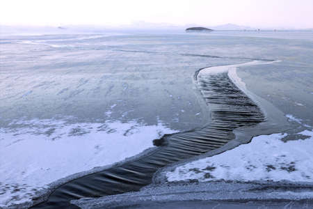 Strong wind breaks ice on water surface, closeup view Stock Photo