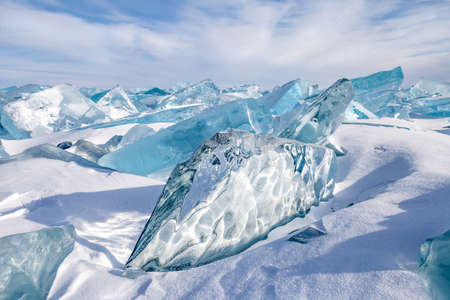 Beautiful blocks of blue natural ice on sky background. Stock Photo