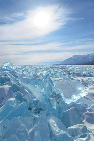 semitransparent: Blocks of semitransparent blue ice on sky background Stock Photo