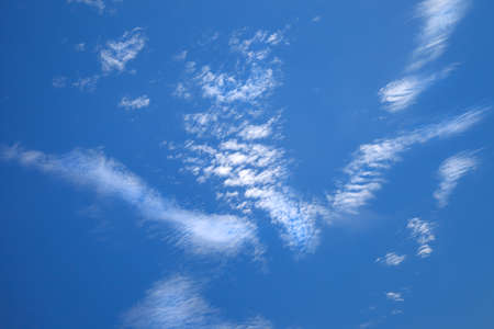 Light white cirrus clouds of beautiful shape on blue sky Stock Photo