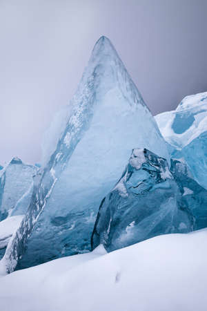 Beautiful crystal blue ice blocks, scenic winter landscape, close-up view Stock Photo