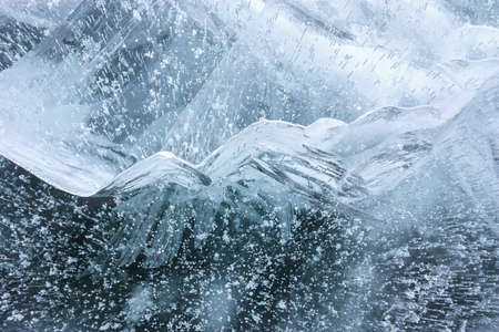 Beautiful crystal ice pattern with bubbled structure, abstract winter background in soft blue colors, closeup view Stock Photo