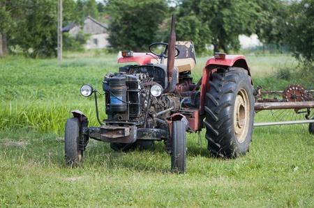 Old tractor on green grass photo