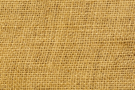 Twig, rush, rattan, reed, cane, wicker or straw mat background of natural color photo