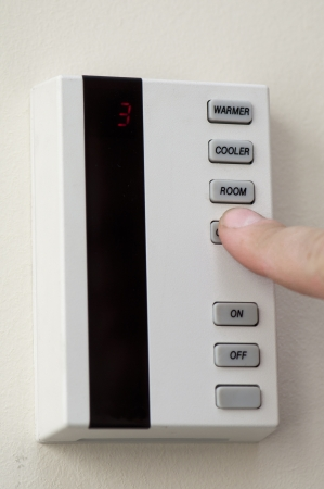 conditioned: panel of the air conditioning system - finger presses Stock Photo
