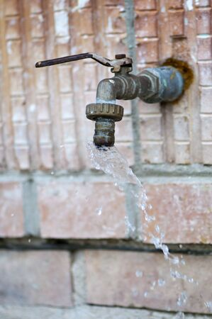 waste of water - an old, leaky faucet photo