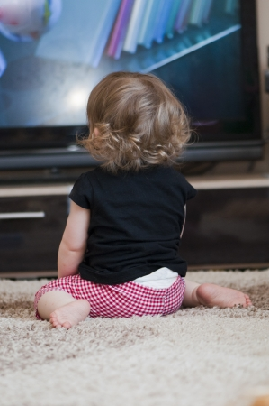 people watching tv: little girl watching television