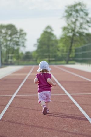 little girl runs across the track Stock Photo - 14382343
