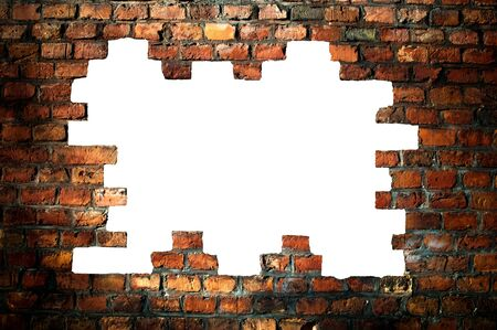 hole in wall: hole in an old brick wall  Stock Photo